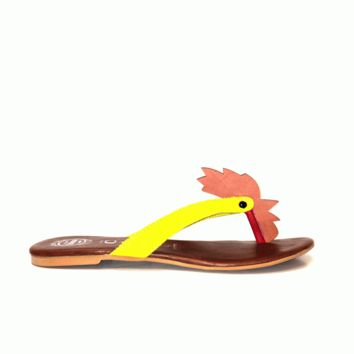 Keep it simple and cute in this Sweet Doodle-Do Thong Flat Sandal by Jeffrey Campbell! Featuring leather strap upper with neon yellow cow hair detailing, rooster head design, leather sock lining, man made outsole, and easy slip on style.