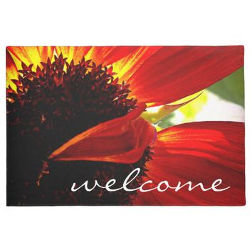 """Welcome"" red orange daisy close-up photo doormat"