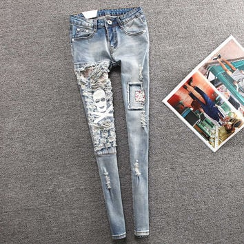 Spring Stretch Ripped Hole Skull Slim Jeans For Woman