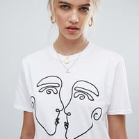 Reclaimed Vintage inspired t-shirt with kissing faces print at asos.com