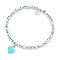 Tiffany & Co.  mini heart tag in sterling silver on a bead bracelet.