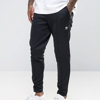adidas Originals Pharrell Slim Joggers In Black BR1835 at asos.com