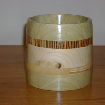 Hand turned wooden bowl made of recycled wood and turned on a wood lathe.