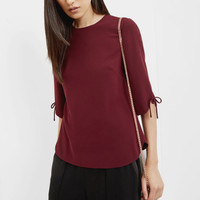 Bow detailed top - Oxblood | Tops & T-shirts | Ted Baker ROW