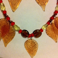 blown glass leaves necklace in fall colors,red yellow and brown