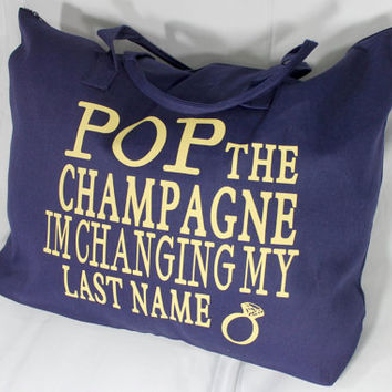 Pop the champagne i'm changing my last name. Large tote