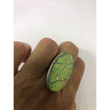Vintage green Opal vintage Art Glass ring about an inch long knuckle ring