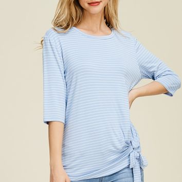 3/4 sleeve striped knit top with a round neck featuring a front twist knot