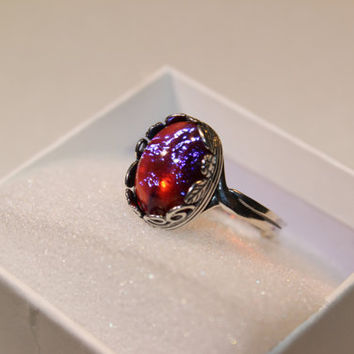 Dragons Breath Mexican Fire Opal ring ringed in leaves and spirals. Antiqued Sterling Silver (925).  Adjustable ring set to one size.
