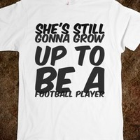 SHE'S STILL GONNA GROW UP TO BE A FOOTBALL PLAYER