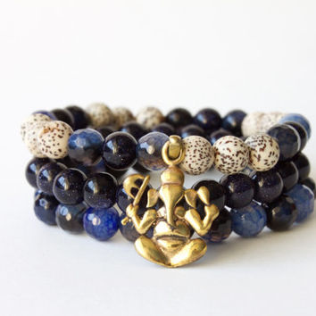 Ganesh Stack - 3 Bracelets Made with Lotus Seeds, Blue Agate, and Blue Sandstone Beads with Ganesh Charm