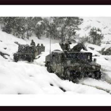 U.S. Marines conducting a mounted patrol in the snowy weather of the Khowst-Gardez Pass, framed black wood, white matte