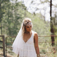 Bohemian vintage style wedding dress with fitted French lace cups and babydoll style panelled skirt