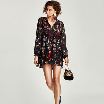 EMBROIDERED DRESS WITH POMPOMS DETAILS