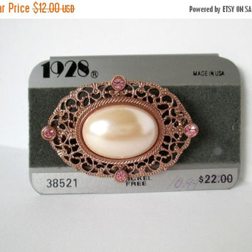 Vintage 1928 Jewelry Brooch Lovely Large Center Pearl Surrounded with Pink Rhinestones in Gold Metal New On Card Never Used Very Nice