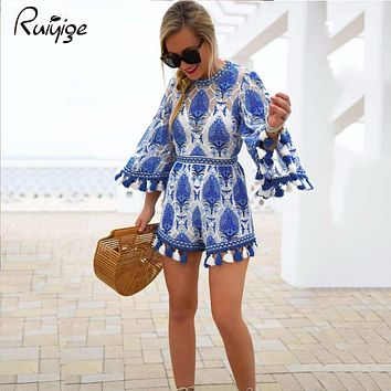 2017 Flare Sleeve Women Playsuits Tassel Rompers Women Jumpsuit Blue Floral Pattern Loose Lady Clothes Summer Beach Playsuit