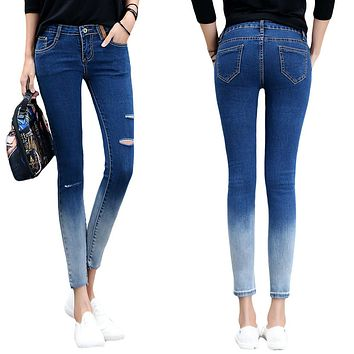 *online exclusive*  ripped ombre skinny jean