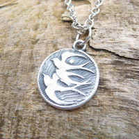 Swallows in flight, handmade from recycled silver