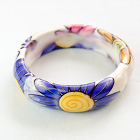 Super colourful plastic flower bangle. Cheerful, painted flowers on a white background. 1980s. Hippy.