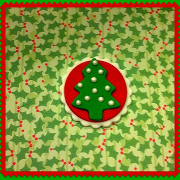 Cute little Fondant Dark Green Christmas tree on Red background, with White Sugar Pearls