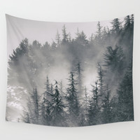 """Lost"". Into the foggy mountains Wall Tapestry by Guido Montañés"