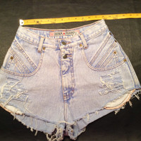 Vintage high waisted Levi's inspired cut off destroyed denim shorts