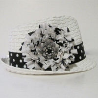 White Packable Fedora with Black and White Polka Dot Trim and Chiffon Flower and a Silver and Black Rhinestone Pendant Accent