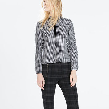 Checked trousers with piped waist