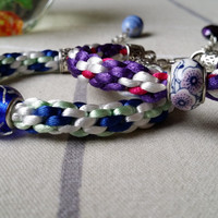 White, Blue and Light Green Braided Bracelet, Satin Cord Kumihimo Bracelet with Central Glass Lampwork Bead.
