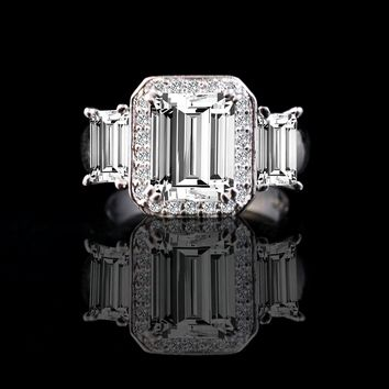 2 CT. Emerald Cut Center with two side baguettes Simulated Diamond - Diamond Veneer Vintage Ring