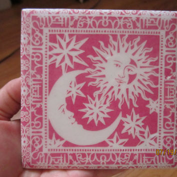 Celestial. Sun and moon with light pink background ceramic tile coaster