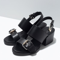 High heel sandal with buckles