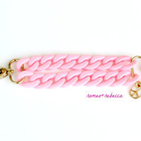 light pink acrylic double strand bracelet with peace charm