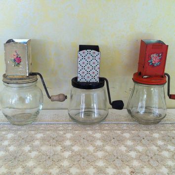 Set of 3 vintage Hazel Atlas Androck coffee/nut/spice grinder with glass jar.