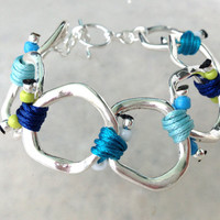 Spring 2014 Collection Silver Ring Bracelet with Blue Tone Cords