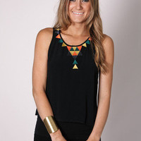Esther Boutique - marquee black top- orange detail