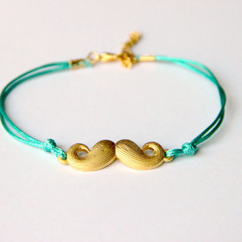 """Minimalist Bracelet gold plated moustache with green string Alexander Henry's """"Where's my Stache"""""""
