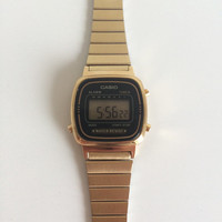 vintage casio watch / gold strap / digital face / water resistant / stainless steel / 3191 LA670W