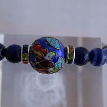 Dark Blue and Denim Blue Hues Czech Stretch Bracelet with a Central Vintage Colourful Enamelled Bead .