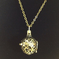 Antiqued bronze prayer ball necklace