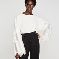SWEATSHIRT WITH FRINGED SLEEVES DETAILS