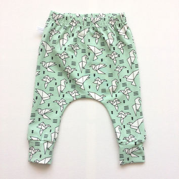 Green baby infant harem pants with origami birds. Slim fit harem pants with cuffs. Mint green jersey knit fabric. Geometric infant pants