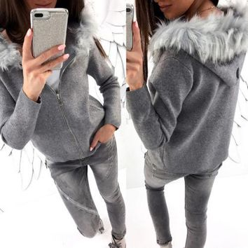 Long sleeve Sweater hoodie with faux fur trim  Sizes: S, M, L, XL