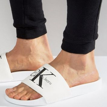 Calvin Klein Viggo Logo sliders in white at asos.com