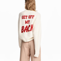 H&M Knit Sweater with Appliqué $49.99