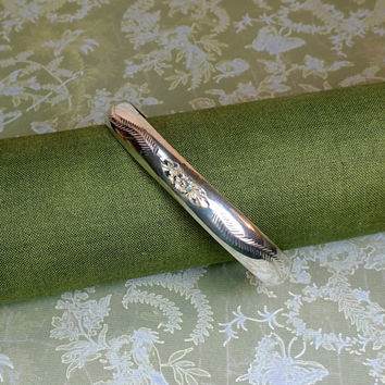 Sterling silver Italy clamper bracelet. Rose floral motif with etched leaves. Locking safety clasp. Timeless beauty!