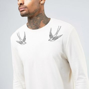 ASOS Super Longline Long Sleeve T-Shirt With Swallow Embroidery And Curved Hem at asos.com