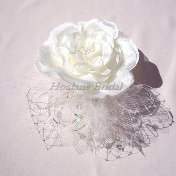 Ivory silk flower headpiece with french netting/tulle bows