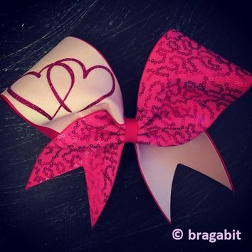 Pink sequins cheer bow with hearts.