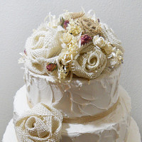 Ready to Ship! Burlap Rose Wedding Cake Topper. Embellished with ivory lace, babies breath, pink rosebuds and satin ribbon.